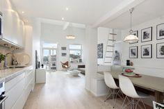 White Loft Apartment With Lovely Views Near Stockholms Hammarby Lake #interior #loft #white #design #decor #furniture #lake #apartment #view