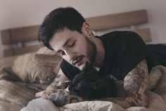 tattoed guy with cat