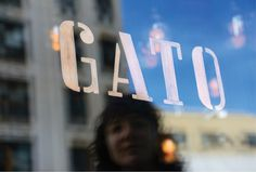 The logo has been hand painted in copper foil on the restaurant windows. #type