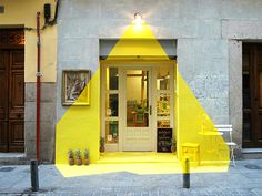 (fos) creates an illuminated installation out of paint and tape #door #yellow #restaurant #light #entrance