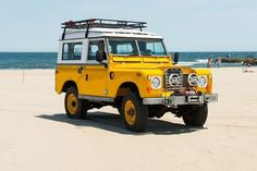 Drop Anchors #car #land rover #yellow #beach #1960s