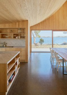 This Scandinavian Wooden House Has a Tent-Like Roof Over a Generous Interior Space 9