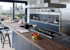 Luxury Penthouse Designed by Amos and Amos kitchen range cooker basaltina stone worktops #interior #kitchen #design