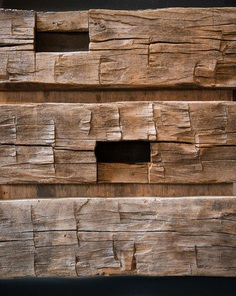 Score marks give hand hewn timbers their signature look and texture prized by homeowners.