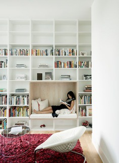 woman reading a book in a room