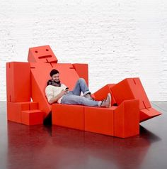 Dezeen architecture and design magazine #man #lounge #chair #robot