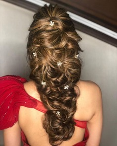 Loosely Tied French Braid Decorated With Flowers