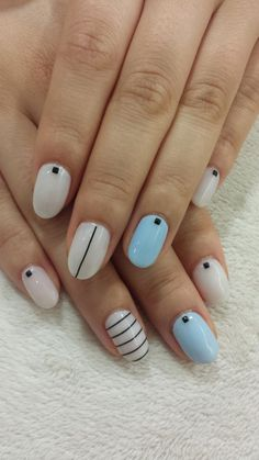 Love simple and clean nail look? These artistic nails will fit you perfectly while going to school or work. Laced with pale and plain colors