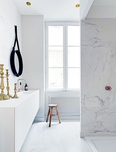 Bathroom. A modern French apartment within an opulent 19th-century shell. Photo by Felix Forest. #bathroom #felixforest #marble