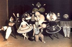 Oskar-Schlemmer-triadic-Ballet-costumes-in-theatrical-magazine-Metropol-Again-Metropol-Theater-Berlin-1926.jpg 1,261×836 pixels #bauhaus #photography