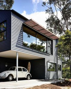 """Sweet house, love the underneath garage, and the """"outside sun-guards"""" especially #modern #beetle #bug #vw #dwell #wood #surf #surfboard"""
