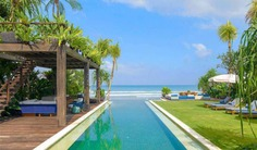 This Beachfront Seminyak Villa is a dream for those who love to entertain, with a fully staffed commercial kitchen, wine room, bar and more. Contact Villa Getaways for Booking.