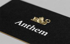 Gold Foil Embossed Logo On A Black Business Card