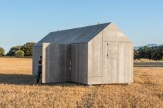 Portable House ÁPH80 is a minimalist house located in Spain, designed by Ábaton Arquitectura. The outside is covered with grey cement wood #small