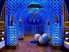 Wine Cellar with artistic lighting of wine racks in blue #house #paintings #residence #art decor #artistic decor #artistic interior