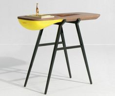 A sleek and peculiar cure for small clutters, table that helps you organize the uncategorizable things inside your otherwise perfectly arran