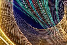 Curving multicolor light beams