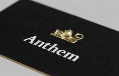 Logo and business card with embossed gold foil detail by Anagrama for football scout and transfer business Anthem