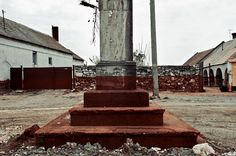 photographs capture town stained red by hungary's 2010 toxic waste spill #photography