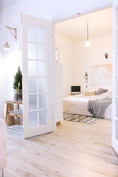 Work Around the Weird: Design Ideas for Tricky-to-Decorate Spaces | Apartment Therapy #apartment #interior design #white #wood floor