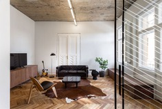 Trendy Terrazzo and Herringbone Parquet at Renovated Apartment by Alexandru Szűz Pop - InteriorZine