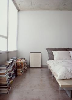 Stripped Ease - Slideshows - Dwell #interior design #bed #bedroom #books