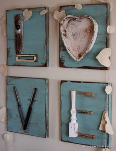 Love letters made with miscellaneous home stuff on old wood plates.