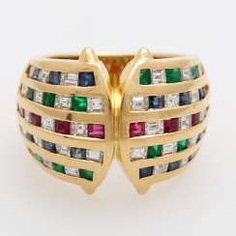 Ladies ring with. The color of precious stones and Diamit
