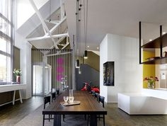 Loft ESN   an Exceptional Transformation into Spacious Living Space long dining table vibia lighting