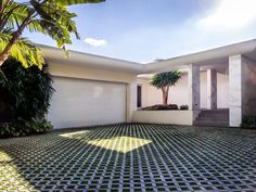 Lenny Kravitz's Former Biscayne Point House - Curbed Miami #patio #concrete #grass