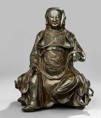 Bronze of seated dressed Zhenwu in a suit of armor