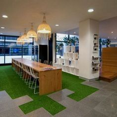 Junction of ict and breakout space floor Grass carpet, interesting board meeting desk. Love the plants around the outside as well! #grass