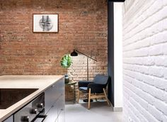 Apartment Renovation with Industrial Accents in Budapest - InteriorZine