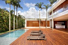 AN House  by Guilherme Torres an house wooden deck