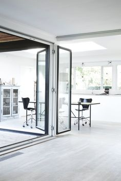Hallway and dining area with bifold doors. Bang House by Norm.Architects. #normarchitects #door