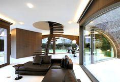 Symmetrical Tripartite Villa Moerkensheide three large arched windows ground floor
