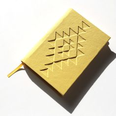 NATIVE, hand-made notebook, journal. Find out more here: www.etsy.com/shop/TandemDesignsShop #notebook #textil #binding #fabric #limited #edition #embossed #bound #yellow #journal #geometric #cover #handmade #triangles #hard #canvas