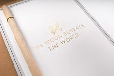 The Wood Beneath The World on Behance #stamp #branding #invitation #embossed #wood #trees #identity #envelope #gold #stationery #programme #ticket #foil #keys