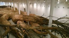 Henrique Oliveira Constructs a Cavernous Network of Repurposed Wood Tunnels at MAC USP #wood #instillation