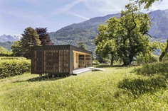 Exterior, Tiny Home Building Type, Concrete Siding Material, and Flat RoofLine Custom-perforated Swisspearl anthracite panels—made of minerals, sand, and cement—allow light to flow into the pavilion.