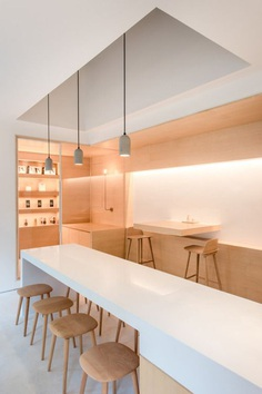 "leibal: ""In and Between Boxes is a minimal space located in Guangzhou, China, designed by LUKSTUDIO. Following a process of meticulous spatial carving, openings and niches are shaped within the volumes. Large cut-outs connect the café to the exterior..."