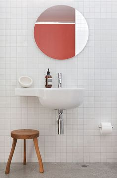 White subway tiles and coral walls in bathroom