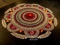 Red and white colored rangoli design