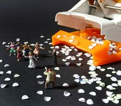 Tiny people take on office stationery in one imaginative photo collection
