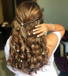 Greek Braids In Wavy Hair Embellished With Flowers