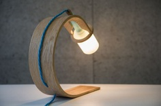 Quercus: Sustainable Lamp Made From Waste - IPPINKA Designed for both function and planet, Quercus is a lamp that is sustainably sourced and fully recyclable. Quercus is made from wood sourced from naturally fallen British Oak. The process is simple: the timber is bent through steaming and treated using nut-based oils. This approach creates a product that, after its long lifetime, will degrade in to nature's recycling system.