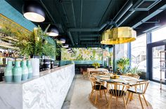 Bogdan Ciocodeica Create Fresh Decor for Kane Restaurant - InteriorZine