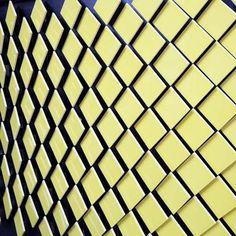Dezeen » Blog Archive » Step Inside bar by Giles Miller #tiles #miller #faceted #yellow #giles