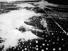 The union of the mathematician with the poet, fervor with measure,... - but does it float #clouds #white #aerial #city #lights #black #dots #photography #plane #and #view