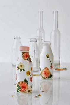 Decoupage! You can paint your wine or any glass bottle in opaque white. When the paint is completely dry, you can select beautiful motifs an